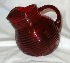 Manhattan Ruby Pitcher by Anchor Hocking Glass Co. ca 1938-43$350  Sell one like this    Manhattan Ruby Pitcher by Anchor Hocking Glass Co. ca 1938-43