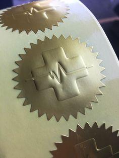 Embossed on Matt Gold foil Paper stickers for House Call Doctors Australia.