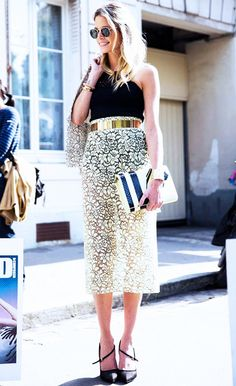 Pair a sheer lace skirt with a leotard and shiny gold belt for a sexy but sophisticated look