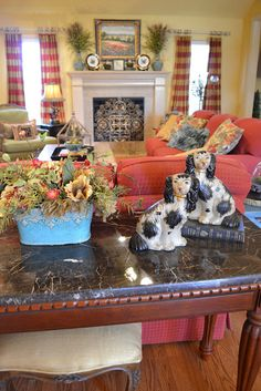staffordshire spaniels; red curtains and chairs~Kristen's Creations