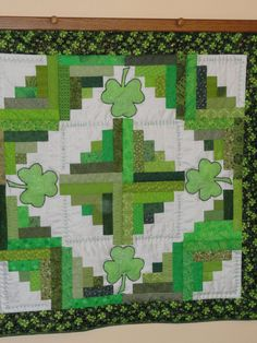 Happy St. Patrick's Day, Appliqued  and Embroidered Shamrock Lap or Baby Quilt,  Patchwork background highlights the Applique Shamrocks.. via Etsy.