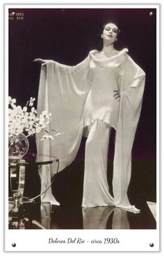 1930 Fashion with Dolores del Rio dramatic glam photo print ad vintage fashion style long evening gown white dress bias cut massive long open bell sleeves formal movie star portrait silk Glamour Vintage, Old Hollywood Glamour, Golden Age Of Hollywood, Vintage Hollywood, Foto Fashion, 1930s Fashion, Art Deco Fashion, Fashion History, Vintage Fashion