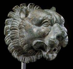 A ROMAN BRONZE SPOUT CIRCA 1ST CENTURY A.D.