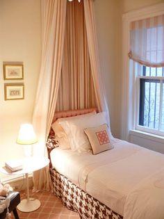 Soft pink bedroom with brown houndstooth bedskirt