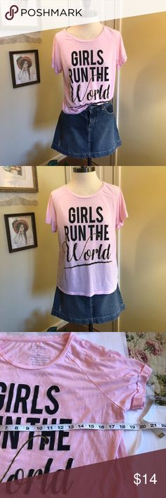 Girls Run The World T Shirt This t-shirt by Freeze is in a poly/rayon blend. Size XL but fits more like a large. Short cuffed sleeves. High low hem. Great condition. Freeze Tops Tees - Long Sleeve