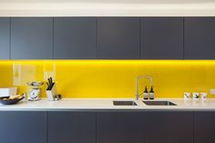 Kitchen Lighting Ideas Yellow splashback, grey kitchen cupboards in a Victorian terrace house renovation in vibrant East London Grey Kitchen Cupboards, Kitchen Splashback Tiles, Grey Kitchens, Home Kitchens, Yellow Cupboards, Yellow Kitchens, Splashback Ideas, Devol Kitchens, Acrylic Kitchen Splashbacks
