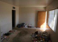 dirty disgusting soiled stained gross carpet junk all over living room Mesa Arizona home house for sale photo
