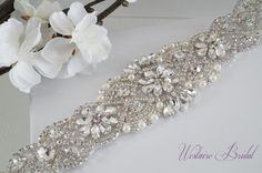 This stunning vintage inspired bridal sash is embellished with pearls and high quality glass crystals. The embellishment is 2 wide x length is available in 18 and 34. The sash is made with double faced satin ribbon 7/8 wide and is 3 yards long. Beautiful addition to your wedding gown. PROCESSING: Please allow 3-5 business days for production. Also be sure to leave the date you require your order or your wedding date. For rush order, please convo us before placing your order.  SHIPPING…