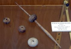 Second century spindle whorls from the site of Martres de Veyre. Possibly walnut. Discovered in Tomb F during 1893. Inventory 987-23-24