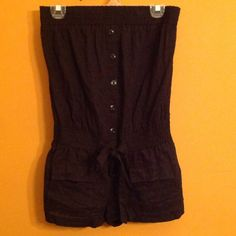 Black romper Black romper with bow tie in the middle. Perfect for a hot day. 2 little pockets on the front. Xhilaration Dresses