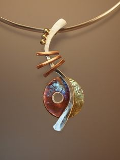"""Picasso guitar"" pendant. Forged sterling silver, textured copper, and textured brass. 2.88"" x 1"" from Johnson Metal Arts"