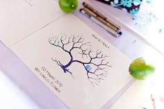 Made the tree template and had guests use green colored inks for thumb prints and micro-sharpies to sign their names. What do you get? Thumb print family tree/guest book. (Photo by Robert Rios)