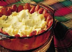 Hot Dog Casserole Potatoes create a base for this classic combination of hot dogs and condiments.
