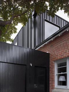 metal panels and brick