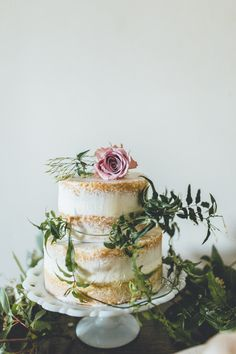 Simple naked wedding cake | Claire Pettibone Wedding Dresses For A Bridal Inspiration Shoot At Boringdon Hall Hotel Devon With An Afternoon Tea Theme And Images From Ross Talling With Styling By Inspire Hire via @rockmywedding