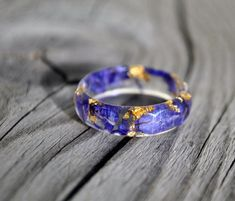 http://sosuperawesome.com/post/136756289165/nature-resin-rings-by-vytvir-on-etsy-so-super