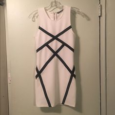 White fitted dress Gorgeous, brand new, perfect condition, never worn dress. Zipper closure in back. Has stretch for a fired right look. Dresses Mini