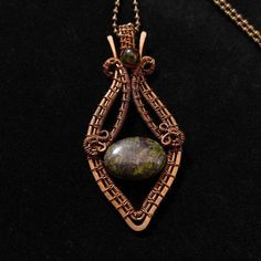 Handmade pendant with green howlite in oxidized antiqued copper wire. Unique wire wrapped vintage jewelry. 2 5/8 X 1 1/8 inch ( 6.7 X 3 cm ) with a chain ( 18 inch )