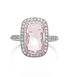 ATTRACTIVE DIAMOND RING, CARTIER, CIRCA 1905 Set with a cushion shaped rose-cut diamond of pink tint, within a frame of millegrain-set single-cut diamonds, size 50, indistinctly numbered, case by Cartier.