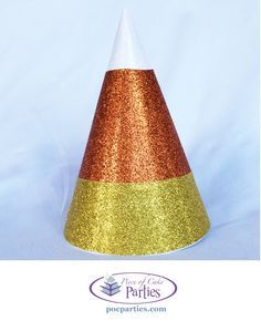 Halloween glittered candy corn birthday party hat by Piece of Cake Parties.  Buy a complete, handcrafted Halloween birthday party-in-a-box at http://pocparties.com.