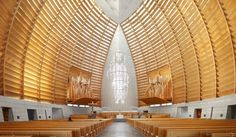 But louvered wood panels encase the interior, providing warm, diffused light for the worshipers within.