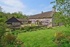 From its circular stair turret to its Tudor arched doorway, heavily beamed ceilings and inglenook fireplaces, this Devon farmhouse, nestled within 12 acre grounds couldn't get much more fairytale. Price when published: £1,250,000 For more info visit humberts.com. MORE: This has to be the best countryside job on offer