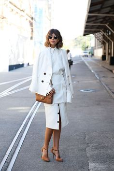 Learn how to pull off a skirt in the winter | outfit ideas via @STYLECASTER | all-white separates and pumps