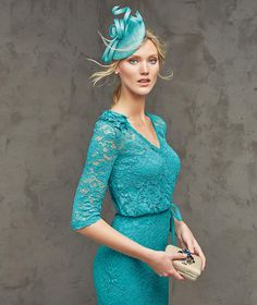FRAGANCIA- Short lace cocktail dress with cross-over neckline. V-neck and decorative gauze flower on the shoulder. Narrow gauze belt with bow.