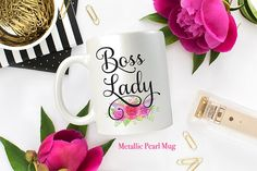 Beautiful metallic pearl mug with Boss Lady embellished with gorgeous pink flowers. • • • M U G • D E T A I L S • • •  • 11oz Metallic Pearl Ceramic Mug • We use the highest quality inks, which will not crack, fade, or wash away* • The design is printed on BOTH sides of the mug • Dishwasher and Microwave safe  * This design is created with a sublimation process that heats the high quality inks on the mug leaving a permanent image that is dishwasher and microwave safe. • For current…