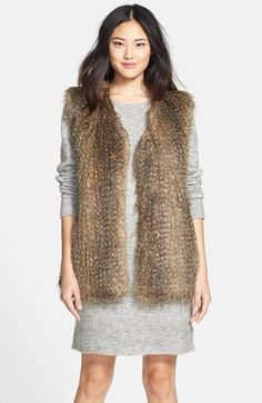 Free shipping and returns on Via Spiga Faux Fur Vest at Nordstrom.com. A collarless V-neck vest crafted from lush faux coyote fur adds an on-trend luxe layer to your look.