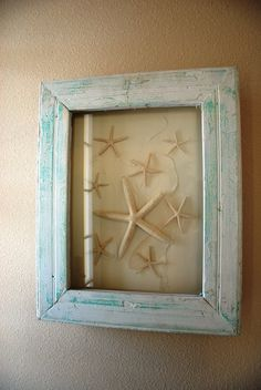 Seashells shadowbox spotted inside a NEW Nocatee model home. Great idea for those who collect seashells. #DIY
