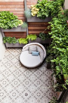 Mosaic tile and walls full of plants make up this coveted outdoor NYC space