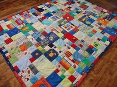 Baby clothes quilt by Lux Keepsake Quilts