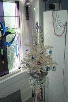 Vintage Christmas tree//On a plant stand, painted white!