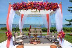 Mandap design, florals by Studio 539 Flowers. Goat Island, Newport #mandapstyle #indianweddinginspiration #indianweddingmandaps