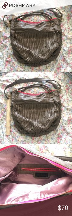 Steve Madden Basketweave Hobo Bag Hello my beauties. This is a gently loved Steve Madden Hobo Bag.  Extremely spacious with removable shoulder strap.  Inside is a light pink satin and the purse has a hot pink trim along the zipper. There's a few chips in the leather which should be in the last photo.  Lemme know if you have any questions.  Happy Poshing. #smokefreeindahizouse Steve Madden Bags Hobos
