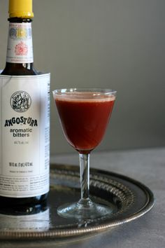 Trinidad Sour: 1 oz. Angostura bitters 1 oz. orgeat 3/4 oz. lemon juice 1/2 oz. rye whiskey (100 proof preferred)  Combine all ingredients in a shaker. Fill with ice and shake until well-chilled. Strain into a coupe or cocktail glass.