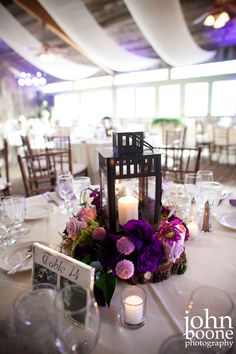 Purple and lavender wedding reception centerpiece by Floral Fields of Burbank, California.