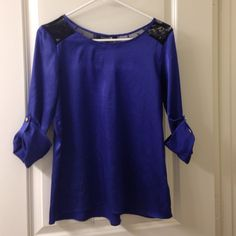 Beautiful blue shirt with black lace Black lace on shoulder and back, great condition only worn once Forever 21 Tops Blouses