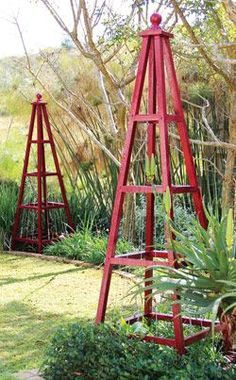 DIY Garden Pyramids Tuteurs-- I'd like to have a lantern on top.