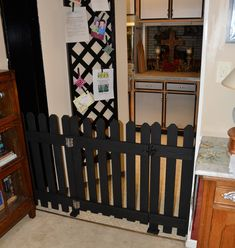 Hand crafted dog gate.  Why buy a $70.00 one when you can make your own for about $20 bucks?!