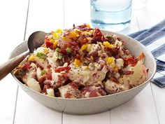 Bacon-and-Egg Potato Salad.  Ingredients 2 pounds small red-skinned potatoes, quartered 1 pound bacon, chopped 2 large eggs 2 tablespoons red wine vinegar 3/4 cup mayonnaise 3 tablespoons whole-grain mustard 6 scallions, finely chopped 1 medium red onion, diced 1 tablespoon sugar Kosher salt and freshly ground pepper Directions Put the potatoes in a medium saucepan and cover with cold water. Bring to a boil, then reduce the heat to medium and cook until fork-tender, about 15 minutes. ...