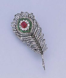 Brooch designed as a peacock feather set en tremblant, the central cushion-cut ruby within diamond and emerald surround to the old-cut diamond plumes and quill, mounted in silver and gold, circa 1890