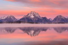 A cool foggy morning makes the towering peaks of Grand Teton National Park even more stunning - http://etsy.me/1pS6z5s