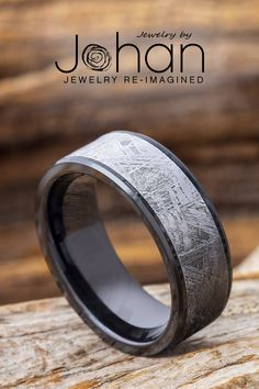Authentic Gibeon meteorite lines the inlay of this handmade black ceramic wedding band from Jewelry by Johan. #JewelrybyJohan