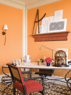 Designer James Lumsden saturates the walls of the Gentleman's Atelier in a lustrous orange to fast-forward the vision of the perfect retreat for the young-English-gentleman-going-to-Oxford. Using many furnishings from his own line, the Las Palmas Collection, Lumsden mixes French Moderne, Italian and English with bold graphics. Red and blue become color complements as do floor coverings in different patterns, creating an exhilarating composition that any student today would find inspiring…