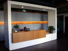 Elevate your office reception desk with amber grain Plyboo bamboo! Reception Counter Design, Office Reception Area, Reception Areas, Modern Office Design, Office Interior Design, Corporate Interiors, Office Interiors, Small Space Office, Office Spaces