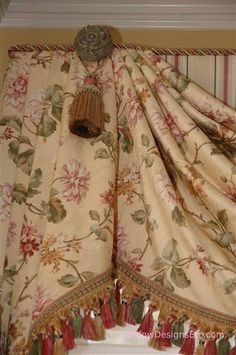 Decorative medallions, tassels and trim enhance the details of the window treatment style.