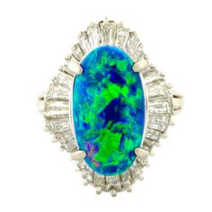 Black Oval Opal And Baguette Diamond Platinum Ring 1950-1960 | From a unique collection of vintage fashion rings at https://www.1stdibs.com/jewelry/rings/fashion-rings/