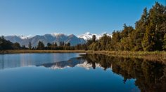 Lake Matheson, near the Fox Glacier in South Westland, New Zealand, is famous for its reflected views of Aoraki/Mount Cook and Mount Tasman. A traditional mahinga kai (food gathering place) for Maori people, the lake contains long finned eel as well as being home to many water birds. (Sebastian Mrozek)